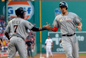 Miami Marlins Reyes and Stanton congratulate each other after scoring against the Boston Red Sox during their MLB interleague game in Boston